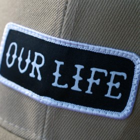 OUR LIFE SOCKS PATCH SNAPBACK CAP